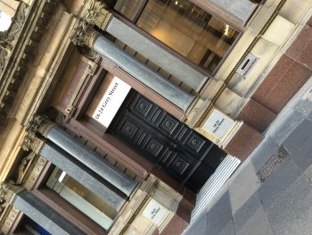 Elegant satin stainless plaques, etched and infilled black, compliment the classical architecture of the 1830's designed Grey Street, Newcastle.